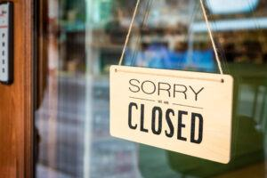 Closed Sign on Business Door
